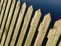 Wooden Fence. A wooden picket fence by a river Royalty Free Stock Image