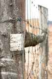 Wooden fence. With metal plate against blurry background royalty free stock images