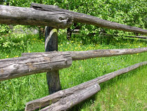 Wooden fence. Old fence made of wooden logs. Old garden Royalty Free Stock Photos