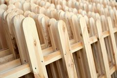 Wooden fence. Several rows of new wooden fence royalty free stock photos