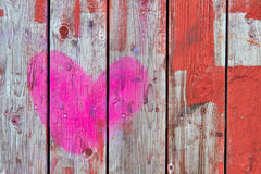 Wooden fence. Pink heart painted on the old wooden fence royalty free stock photos