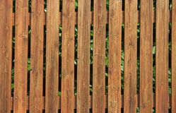 Wooden fence. Nice wooden fence with a bit of green peeking through the slats Stock Photos