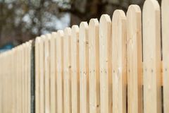 Wooden fence. New wooden fence - closeup shot stock photo