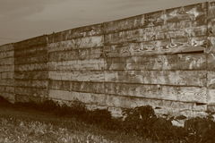 Wooden Fence. Sepia wooden snow fence royalty free stock photography