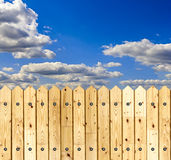 Wooden fence against blue sky background Royalty Free Stock Photos