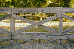 Wooden fence against of bright trees Stock Photo