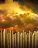 Wooden Fence Against Red Storm Clouds. A wooden fence is in the foreground and red, gold and brown storm clouds are in the background. Use it to symbolize Stock Photos