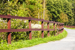 The wooden fence along a dirt road Stock Photos