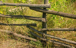 Wooden fence along the road in the countryside. An old wooden fence in rural area on a sunny summer day Royalty Free Stock Photos