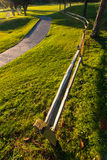 Wooden fence along a walking path with grass Stock Photography