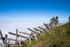 Wooden fence in the alps. A wooden fence above the clouds in the swiss alps stock photos