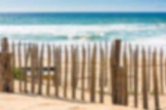 Wooden fence on an Atlantic beach in France Stock Photos
