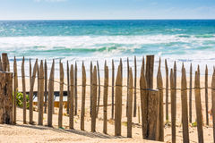 Wooden fence on an Atlantic beach in France Stock Image