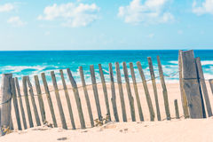 Wooden fence on an Atlantic beach in France Royalty Free Stock Images
