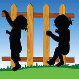 Wooden fence with baby silhouette Royalty Free Stock Photography