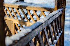 Wooden fence background. Beautiful winter snowy day Royalty Free Stock Photos
