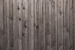Wooden fence background. Dark wooden fence background close up Stock Images