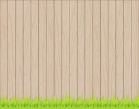 Wooden fence background with grass. Texture Royalty Free Stock Image
