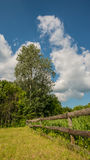 Wooden fence in the background of the meadow in the village Stock Photos