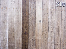 Wooden fence background with number. Old vintage beautiful aged wooden fence background Stock Photography