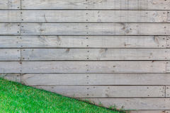 Wooden fence background, outdoor shot. With green grass Royalty Free Stock Photo