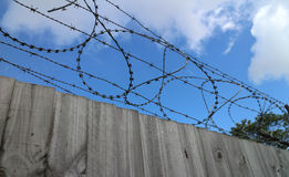 Wooden Fence with Barbed Wire Stock Image