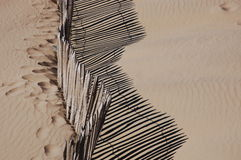 A wooden fence at the beach Royalty Free Stock Image