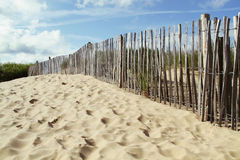 Wooden fence on a beach Royalty Free Stock Image