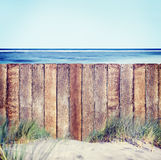 Wooden Fence on the Beach Royalty Free Stock Image