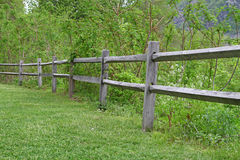 Wooden fence. A beautiful old wooden fence Next to a grass meadow Stock Photography