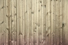 Wooden fence begun to rot from below background Royalty Free Stock Images