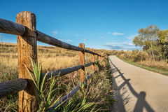 Wooden fence and bike trail Stock Images