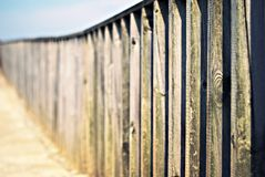 Wooden fence. On a blue background bokeh ending Stock Photography