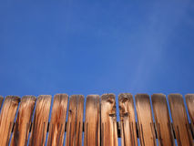 Wooden Fence and Blue Sky Background. A disctinctive wooden fence stans in front of a clear blue Colorado sky.  This image has plenty of copy space Royalty Free Stock Images