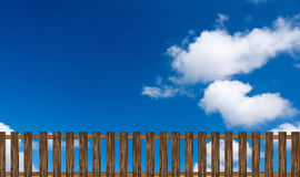 Wooden fence on a blue sky background Royalty Free Stock Images