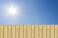 wooden fence with blue sky and sun shines Stock Photos