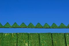 Wooden fence and blue sky. Royalty Free Stock Image