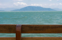 Wooden fence with blur sea view background Royalty Free Stock Image