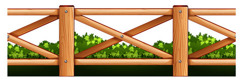 Wooden fence and bush Stock Photos
