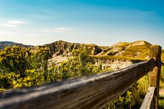 Wooden fence by the canyon in Badlands National Park , SD , USA royalty free stock photos