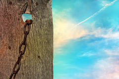 Wooden fence with a chain Royalty Free Stock Photos