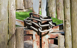 Wooden fence and chains Stock Photo