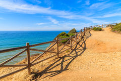 Wooden fence on cliff path Royalty Free Stock Photo