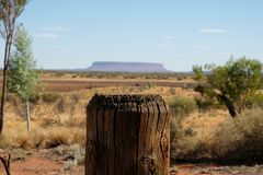 Wooden fence close up and table top mountain Conner in outback on the horizon,wooden fence close up sunny day in Northern royalty free stock photo