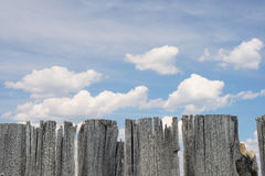 Wooden fence and clouds Stock Photography