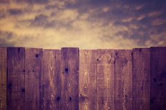 Wooden Fence and Cloudy Sky Royalty Free Stock Photo