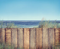 Wooden Fence with Copy Space on the Beach Royalty Free Stock Photo