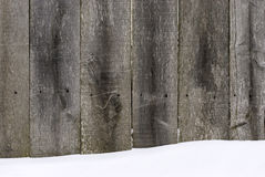 Wooden fence covered with snow. It can be used as a background for Christmas and New Year themes and more Stock Photo