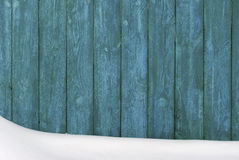 Wooden fence covered with snow. Stock Photo