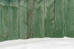 Wooden fence covered with snow. Stock Photos